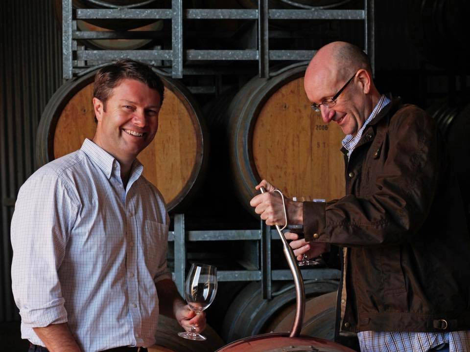 Mitchell Taylor checking the wine barrels