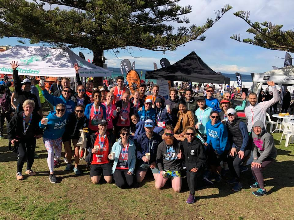 City to surf 2018 Rejoov runners post race rugged up and ready to party