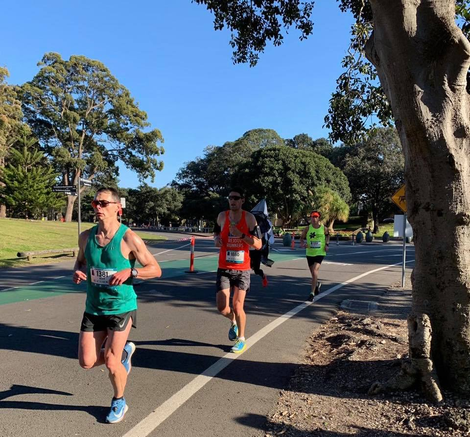 Running through Centennial Park and a tiny bit of shade on a hot day! (Jamie in the stand out orange singlet)