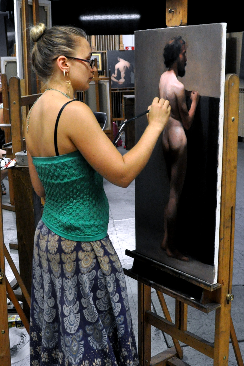 Student painting in workshop