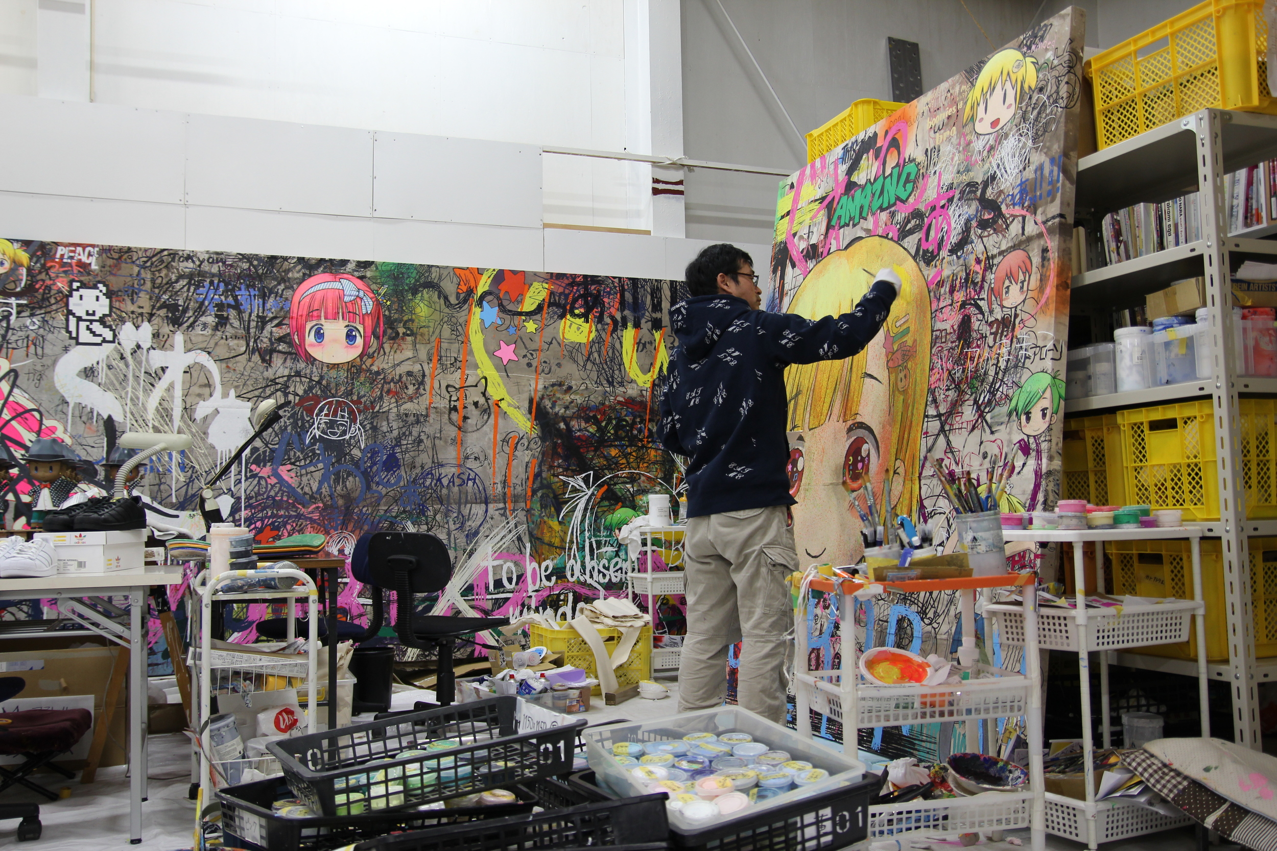 The artist Mr. at work in his studio