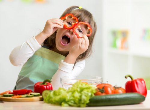 little-girl-playing-veggies-500x366.jpg