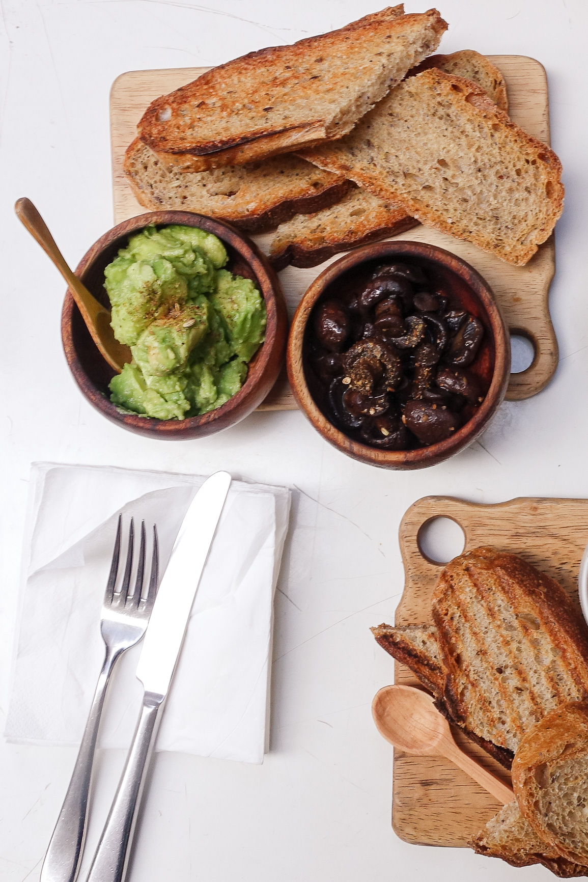 House made whole grain sourdough toast with avocado and swiss brown mushrooms ($10.00, $3.00 for add on of mushroom)