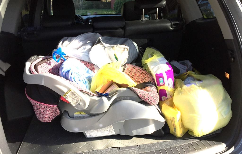 A full trunk-load of items on its way to the American Red Cross in Faulkner County
