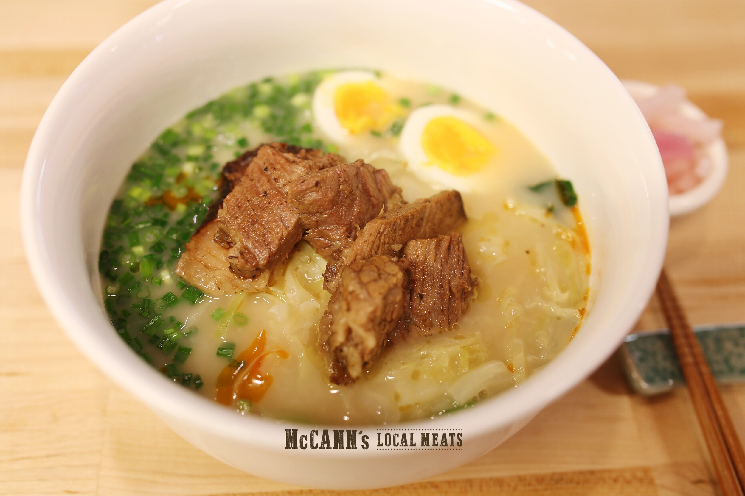 Ramen noodles with braised brisket, bok choy, cabbage, par-boiled farm fresh egg, and spicy beef fat in rich and creamy beef bone broth with miso!