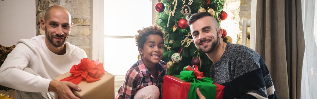 gay-family-with-a-adopted-daughter-celebrating-christmas-picture-id1057525644.jpg