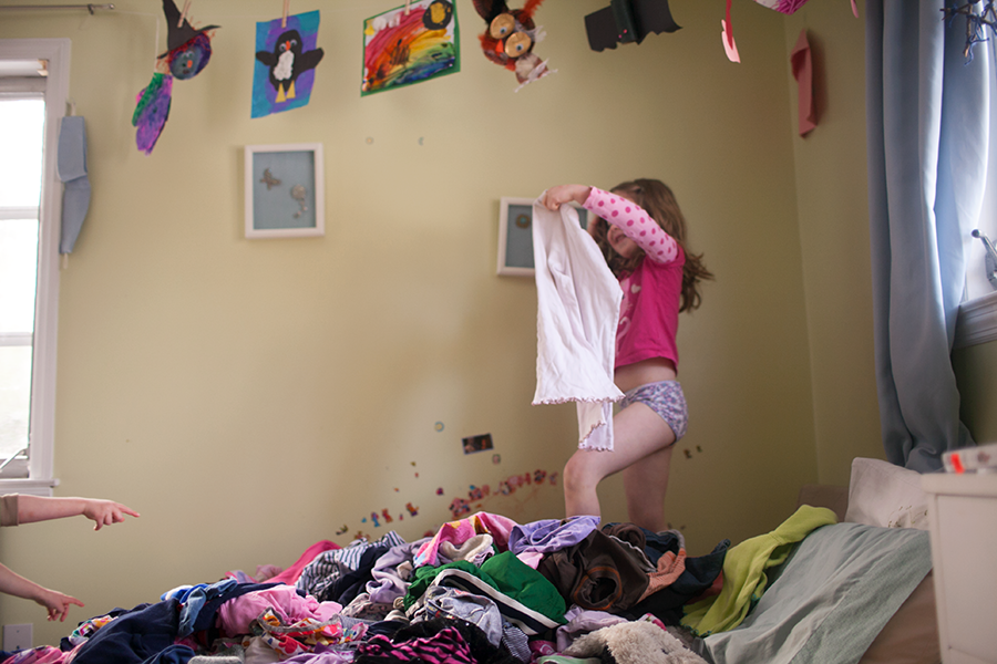 i can't keep up. there are never enough clean socks or underwear or pants. or there are plenty stuffed in laundry bags that pretend to be dressers. this morning your bed became your closet as you searched for a pair of pants to wear to school.     Photo by Heather Robinson Photography     Blog :: Facebook