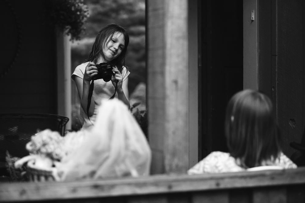 That night I left my make-shift studio to head in and found you had set up your own studio and photoshoot with your sister and some dolls on the deck. And it was beautiful.    Photo by Olivia Gatti     Facebook :: Website