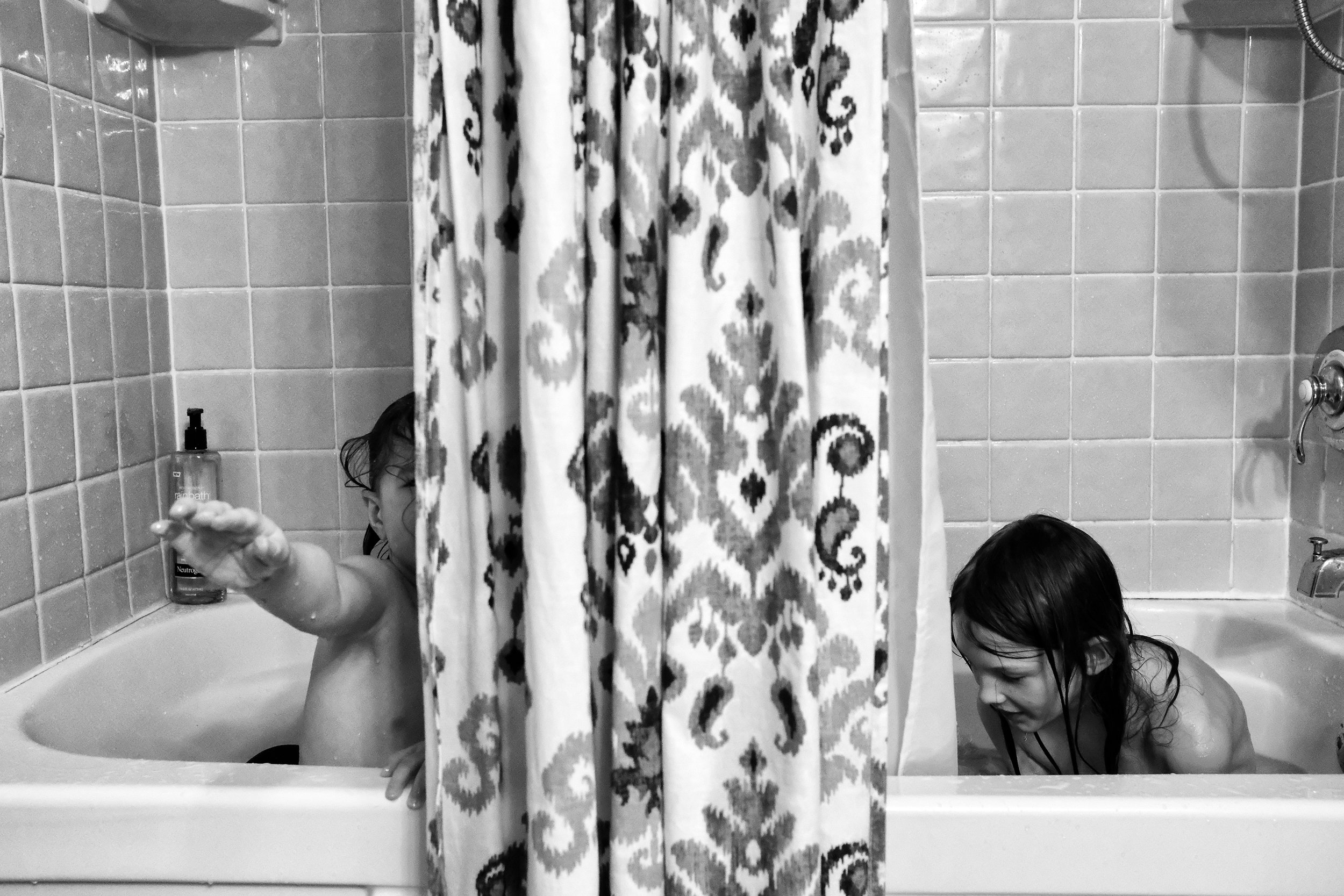 Two out of three sharing a tub is about the best I'm going to get these days. I knew it was coming, almost a year ago, I called it. And thankfully, it doesn't make me sad. In fact, it makes perfect sense knowing her and then knowing you two. I respect that she's past this and I rejoice that you two aren't. I'll be sad when no one needs my help in the tub. Or maybe not. I can't see that far into the future. Who knows? Maybe I'll throw a huge party when I no longer need to be the life guard, the hair detangler, and the tub-toy bleacher.   Photo by Olivia Gatti     Facebook :: Website
