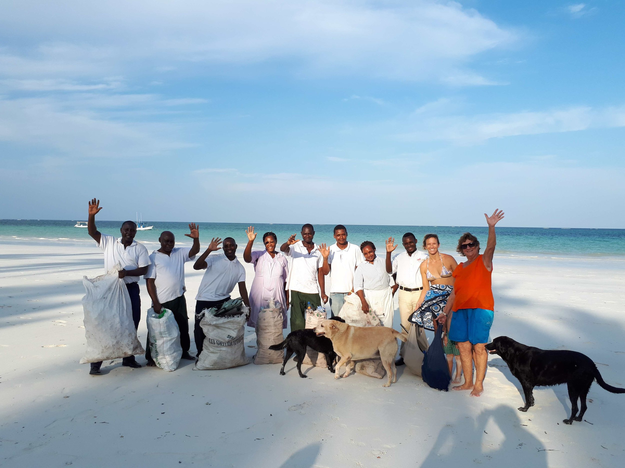 kenyaways team doing beach clean up together