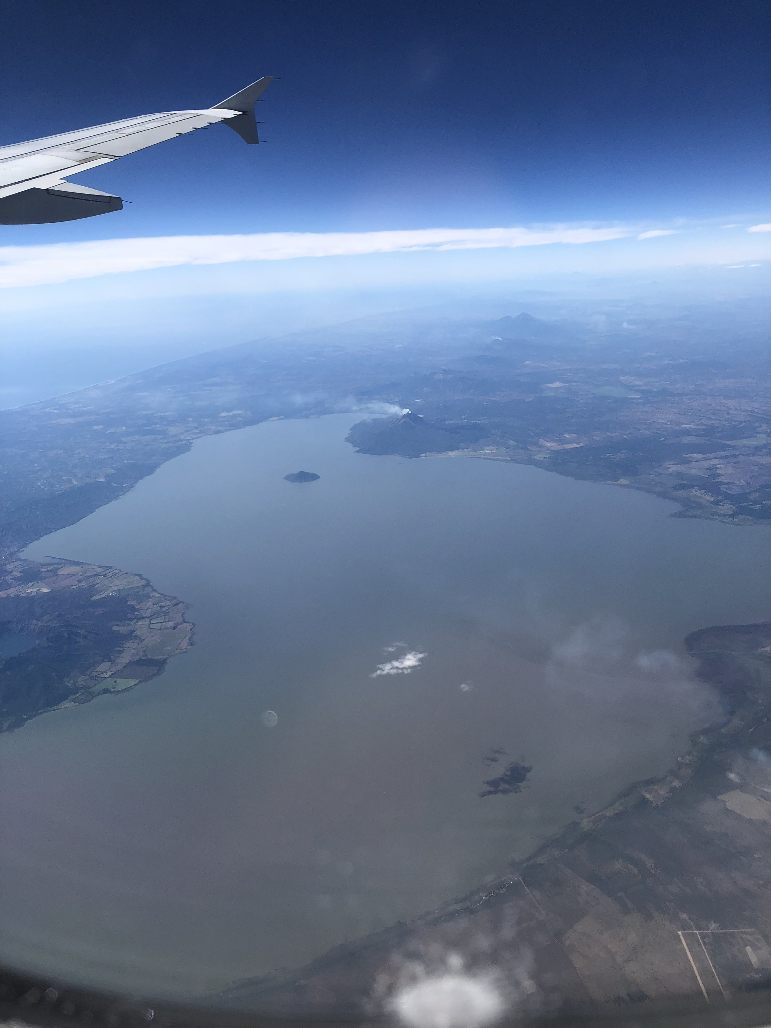 Aerial view of Lake Managua and Momotombo volcano from my window seat.