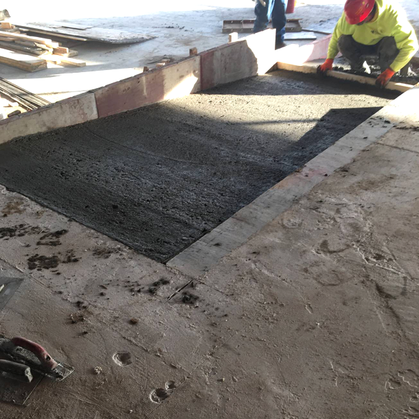 Here the concrete company is installing the new handicap ramp for the office space.