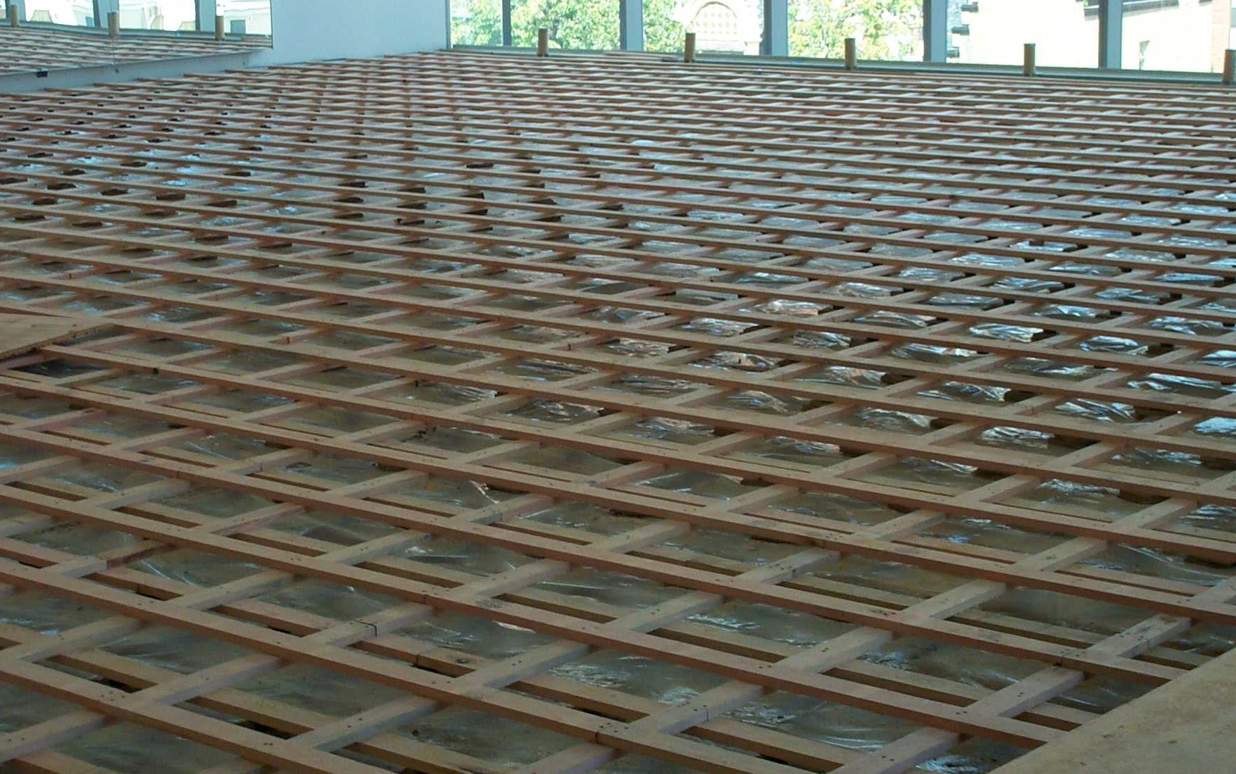 This photo, taken during Project Grand Jeté construction in 2005, shows the inner workings of NBS' studio floors. The layers of wooden boards act as a spring, making the floors ideal for dancers' bodies during hours of daily training. Photo by Nikki Chabrol.