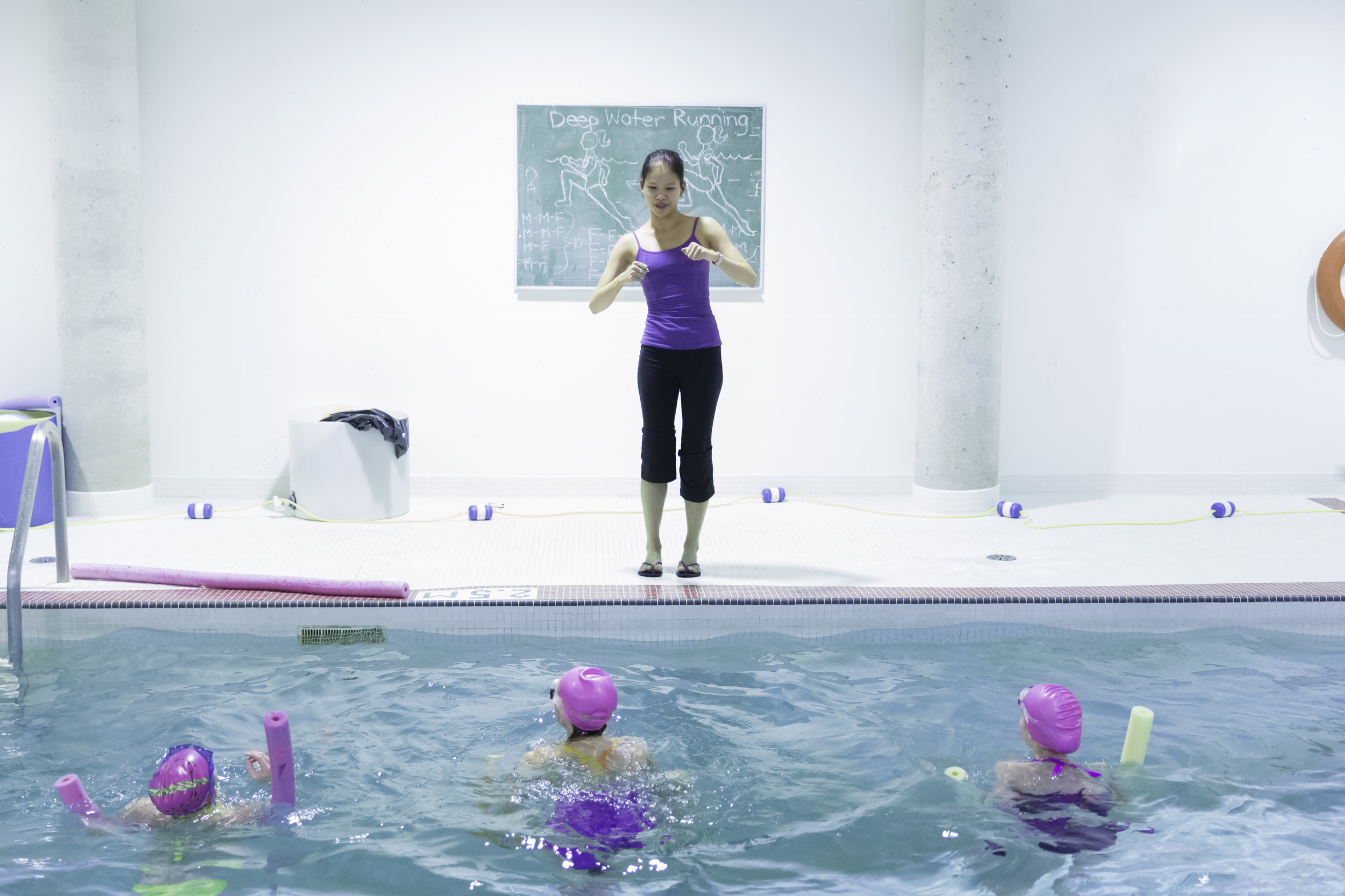 A student in the Teacher Training Program delivers a class in the School's swimming pool as part of NBS'  Conditioning Program.