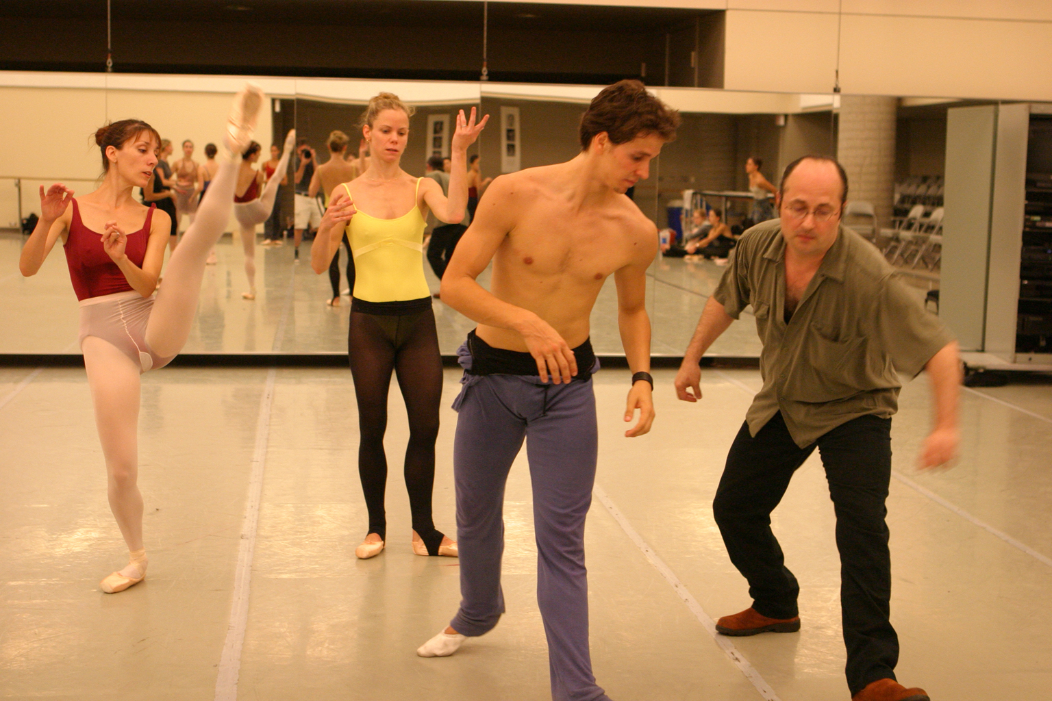 Rebekah Rimsay, Jennifer Fournier, Guillaume Côté and James Kudelka rehearsing Cruel World .Photo by Bruce Zinger, courtesy of The National Ballet of Canada.