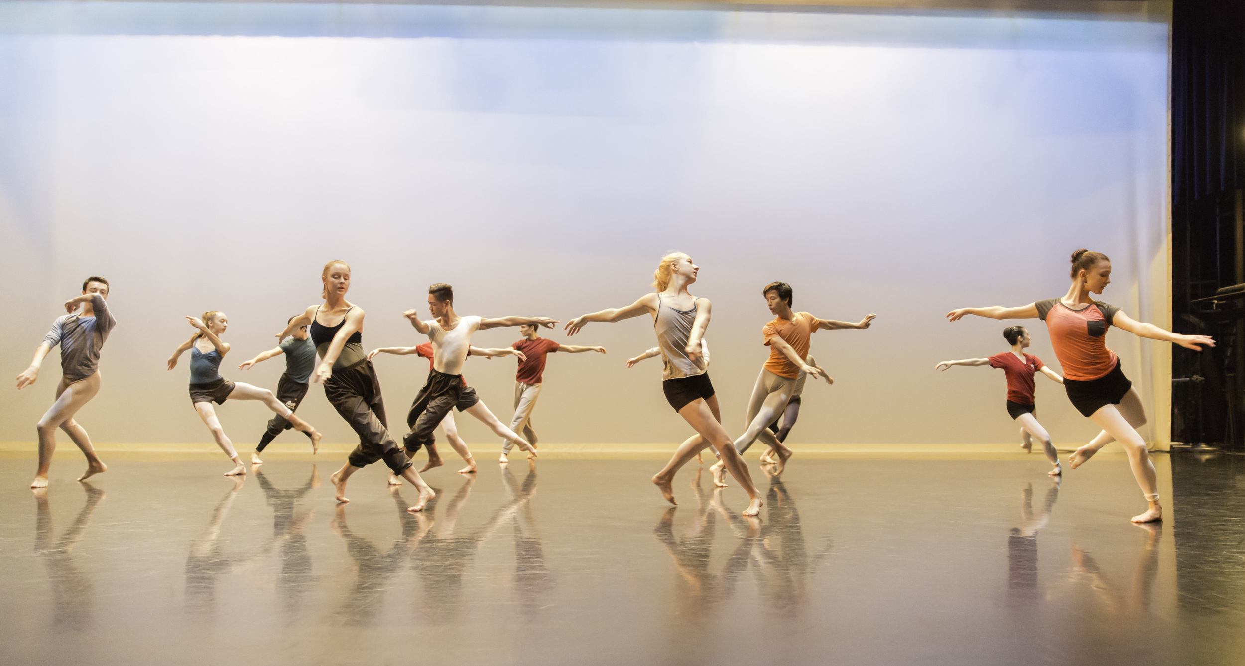 Students rehearse a contemporary dance piece on stage at the Betty Oliphant Theatre. Professional companies increasingly look for dancers who can embrace contemporary choreography just as much as classical choreography.
