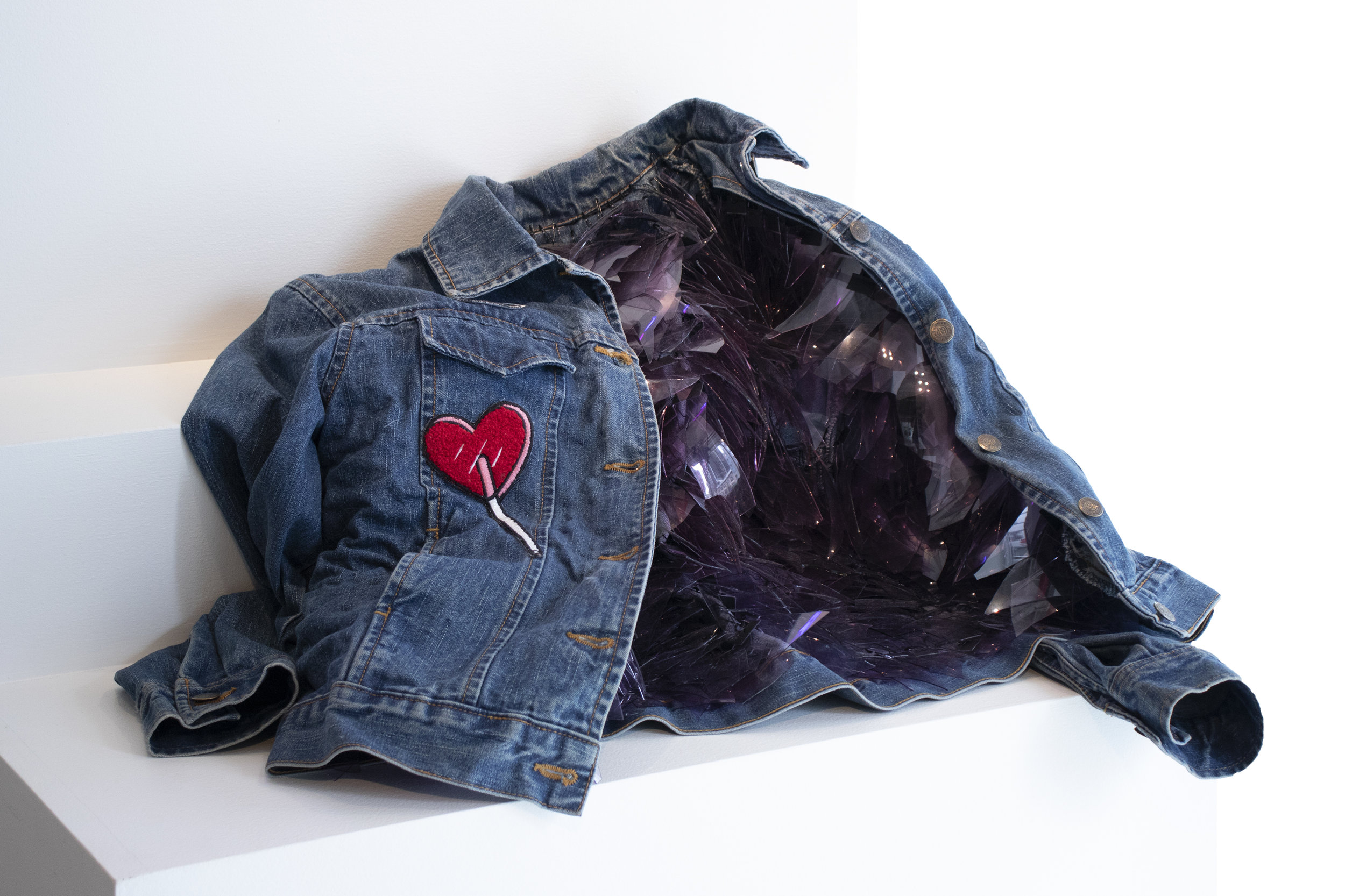 Victoria Ahmadizadeh    Selective Memory   glass, found denim jacket, mixed media 2018