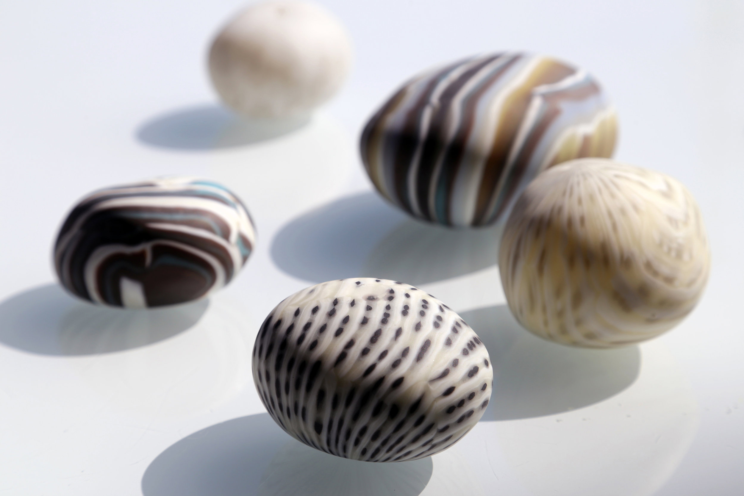"""Hiromi Takizawa   The Little Things   Kiln-formed and blown glass Each rock approximately 3"""" x 2.5"""" x 2"""" 2015"""