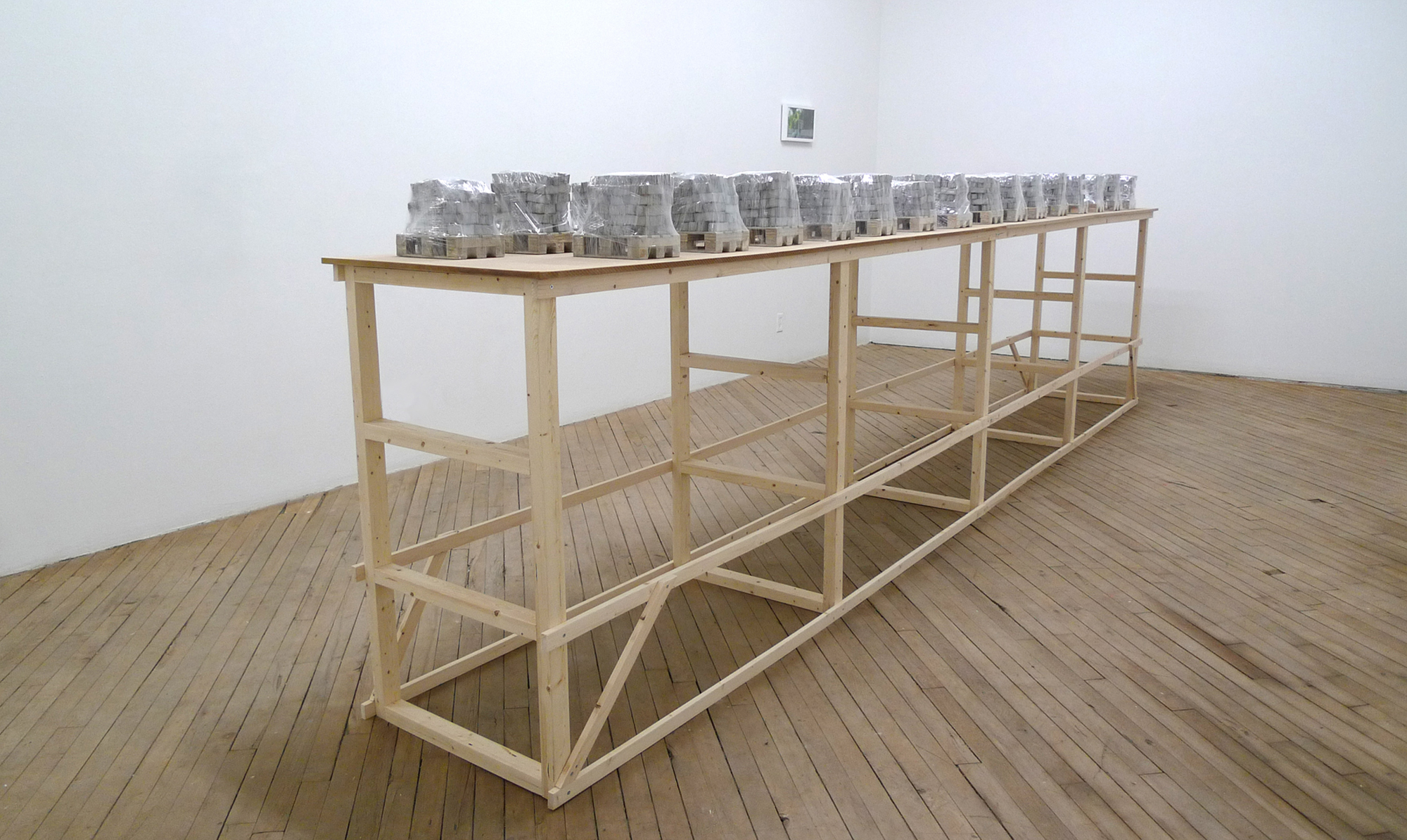Eliza Myrie   Building a Wall Through My Father   (dress rehearsal) concrete, wood, plastic film, pine, MDF each element approximately 6 x 8 x 10 inches table, 192 x 22 x 50 inches 2016