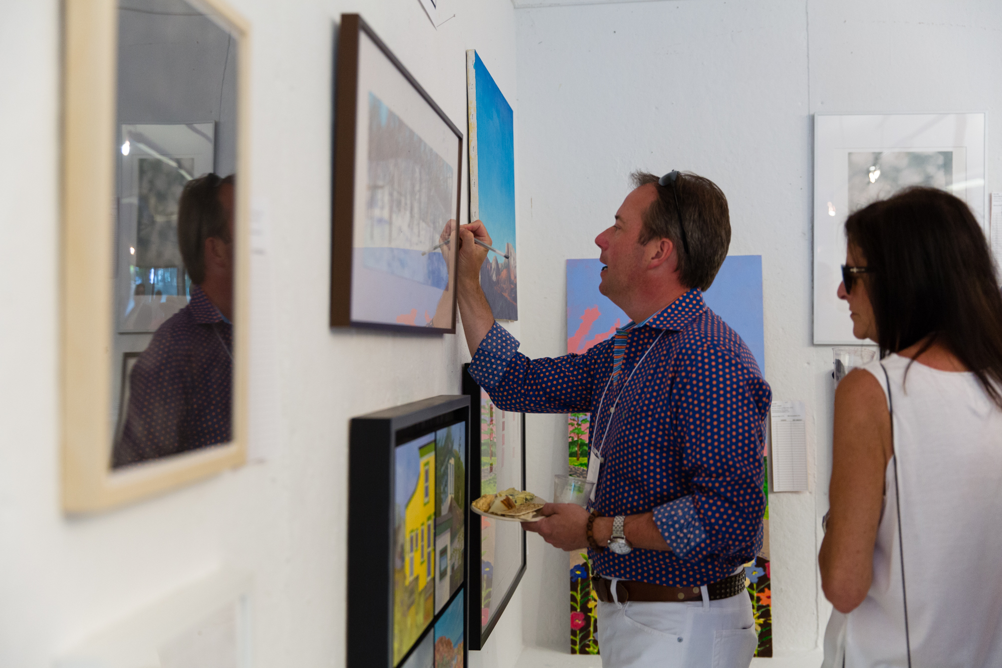 A benefit guest bids on one of our many silent auction artworks