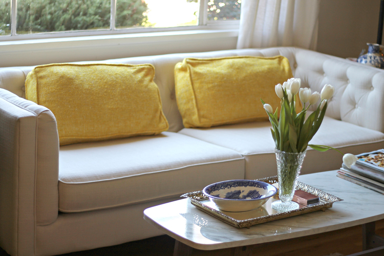 I am in LOVE with these tweed yellow pillows. They give my place a cheery pop and mid-century modern vibe. The impact is large while remaining simple.