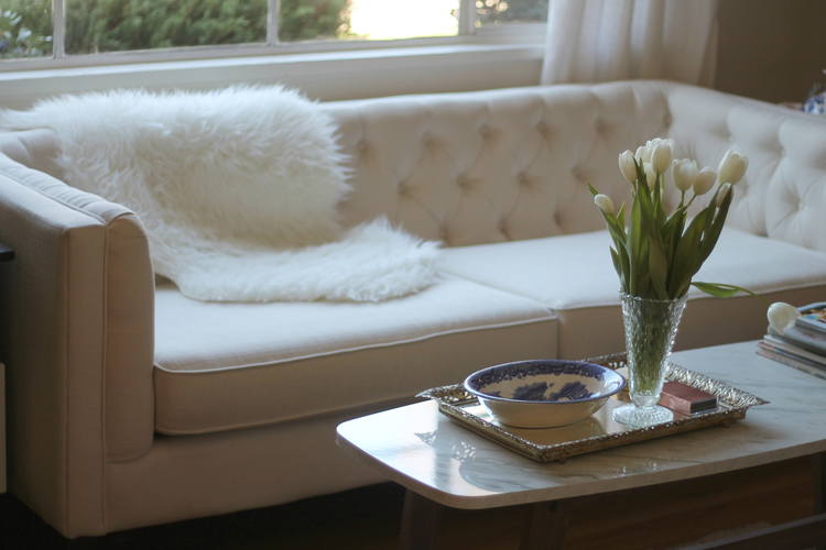 Finally my current favorite. This super inexpensive fur throw from Ikea gives my living room a fun pop of glamour and texture. While working with whites lots of texture is key. White can sometimes feel sterile but the texture gives off a luxurious comfortable vibe.   Which couch styling is your favorite? Let me know!