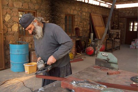 Monk doing maintenance repairs at the monastery.  (Picture courtesy of Massimo Pizzocaro)