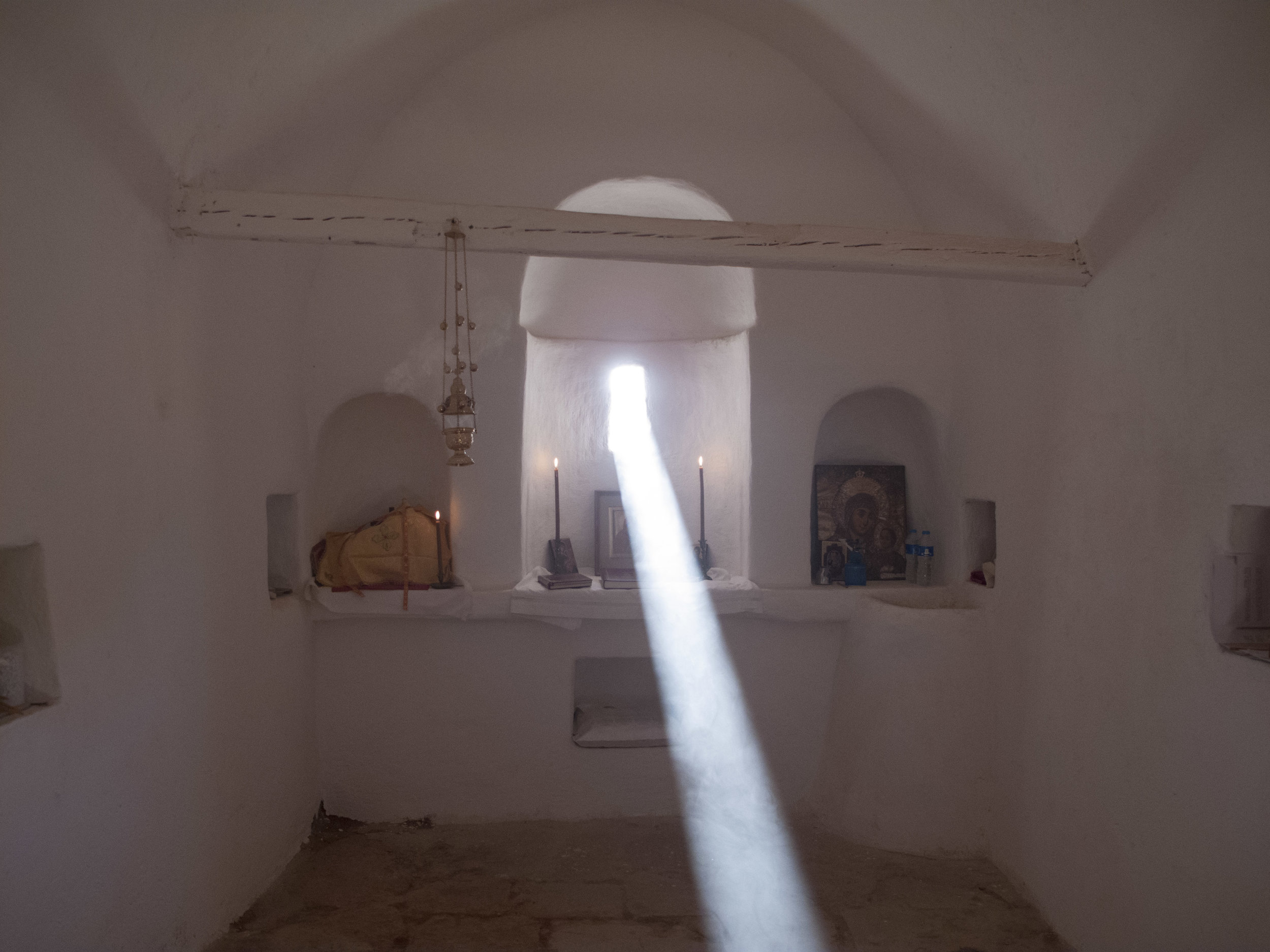 """A beam of sunlight entered through the tiny window of this most beautiful little chapel."" The Chapel of Saint Anne, the mother of the Theotokos, is located high in the Sinai Mountains. (Fr. Justin's Blog:    http://www.fatherjustinsblog.info/archives/4704    )"