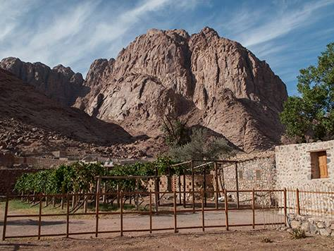 The barren rock of Sinai rising above the Chapel of the Nativity of the Theotokos