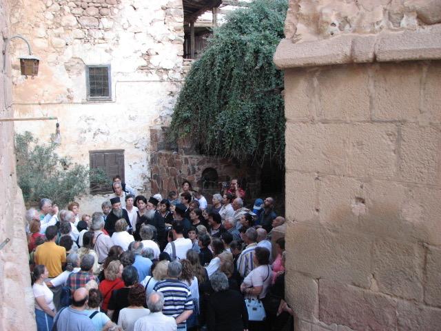 Elder Pavlos with pilgrims at the Burning Bush.