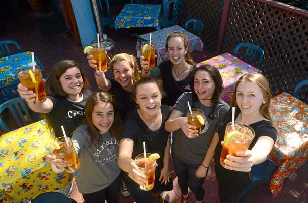 Members of Drake High School's Global Student Assembly hoist their glasses at Taco Jane's on Monday, March 23, 2015, in San Anselmo, Calif. Front row from left: Alexa Neely, Lily Farmer, Audrey Valerio, Maddy Cox. Back row: Alessia Potovsky, Beatrix Berry and Rylie Neely. The students have convinced several local restaurants to stop using environmentally unsound plastic straws, going with paper ones instead. (Frankie Frost/Marin Independent Journal)