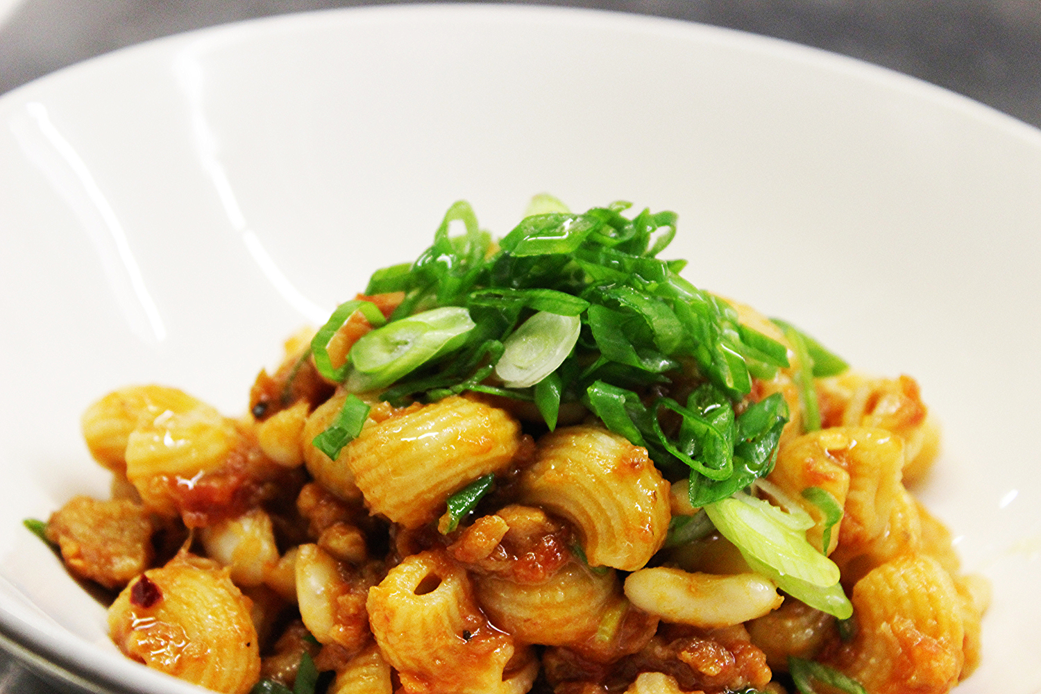 Lumache pasta with monkfish ragu and cannelini beans. Source: Runner & Stone