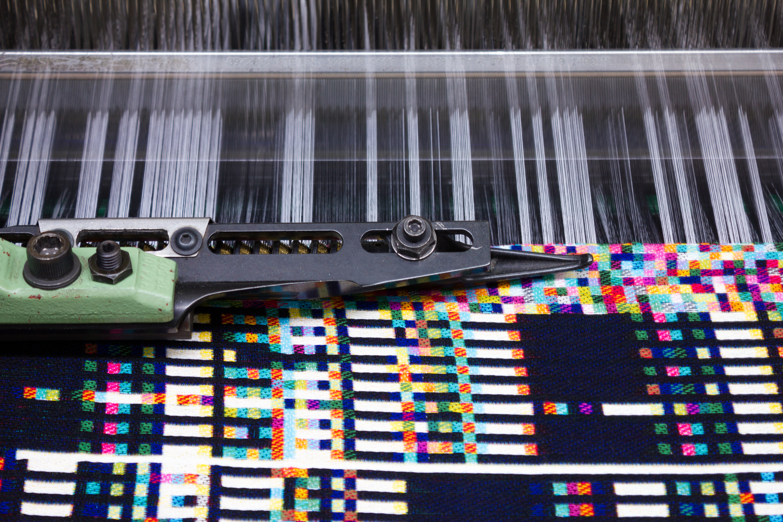 A woven throw in process.  Photo courtesy ofPhillip David Stearns.