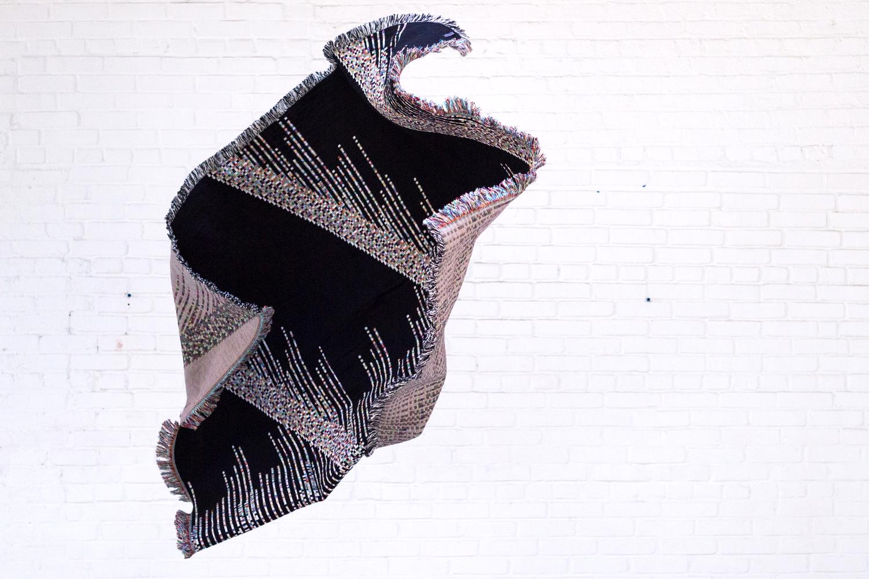 Glitch Textiles in flight.  Photo courtesy ofPhillip David Stearns; taken at Sky Gallery.
