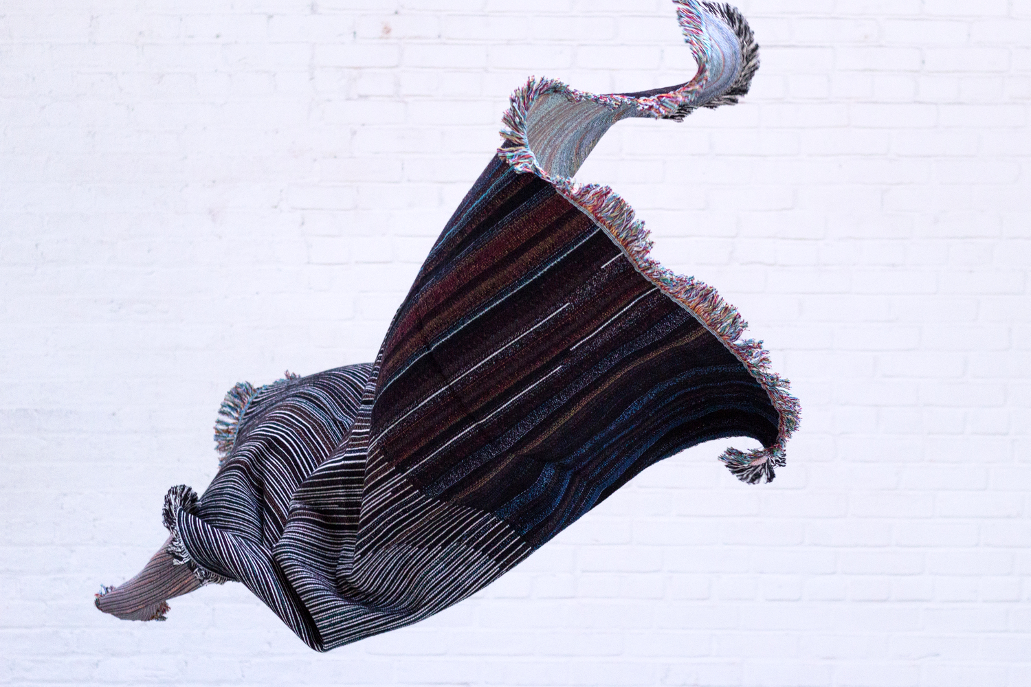 Glitch Textiles in flight.  Photo courtesy of Phillip David Stearns; taken at Sky Gallery.