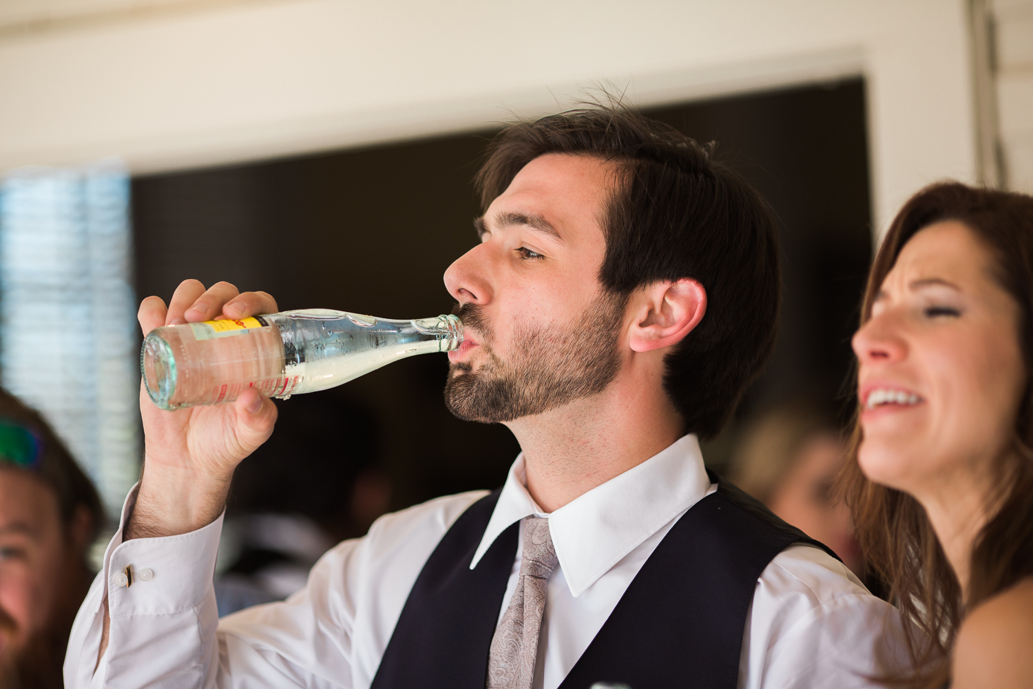 Groom drinking a cold one