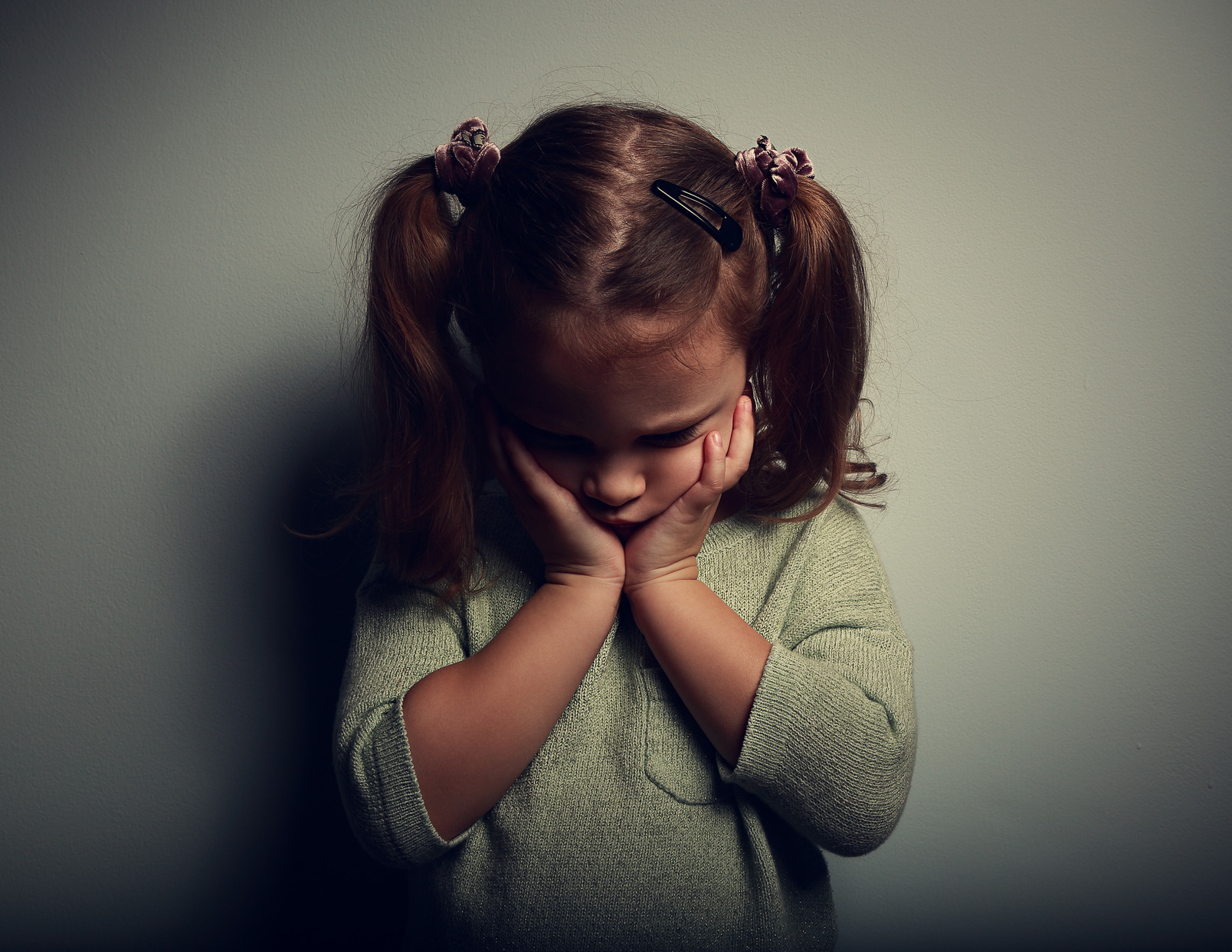 photodune-10722429-sad-crying-alone-kid-girl-on-dark-background-m.jpg