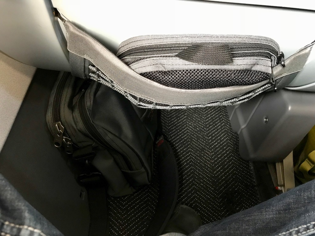 The Tom Bihn Pilot fits easily under the seat of a United aircraft with room for my legs. Pictured above in the seat pocket is the Tom Bihn small Snake Charmer that I use to hold all my cables, earphones, batter backup, and snacks. The Snake Charmer fits perfectly in either front pocket of the Pilot.