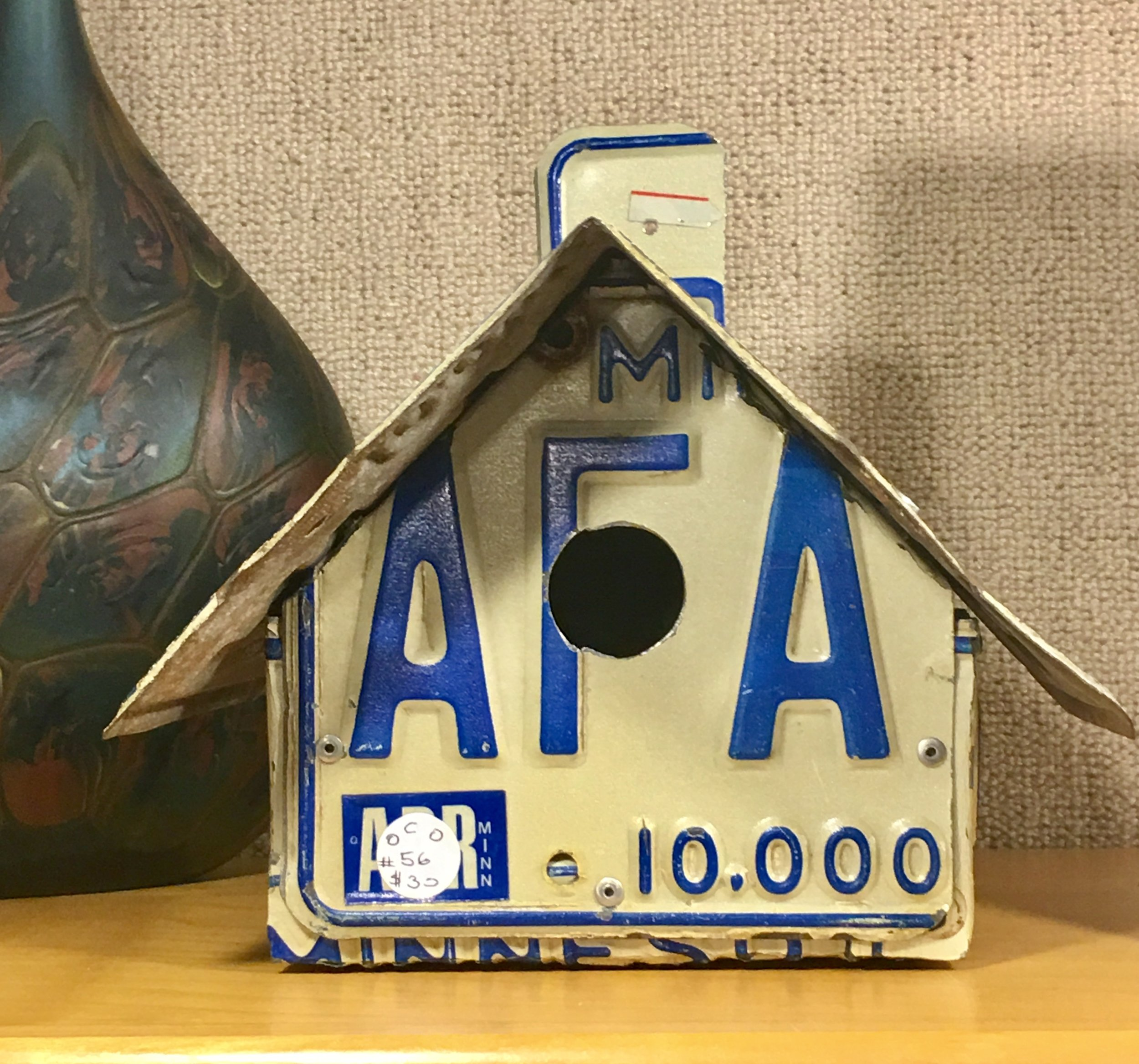 A wren house made from license plates.
