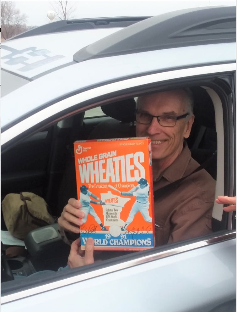 Here I am taking a 1991 Wheaties box, featuring Kirby Puckett and Kent Hrbek on the front, for a ride. It's nice to get out.