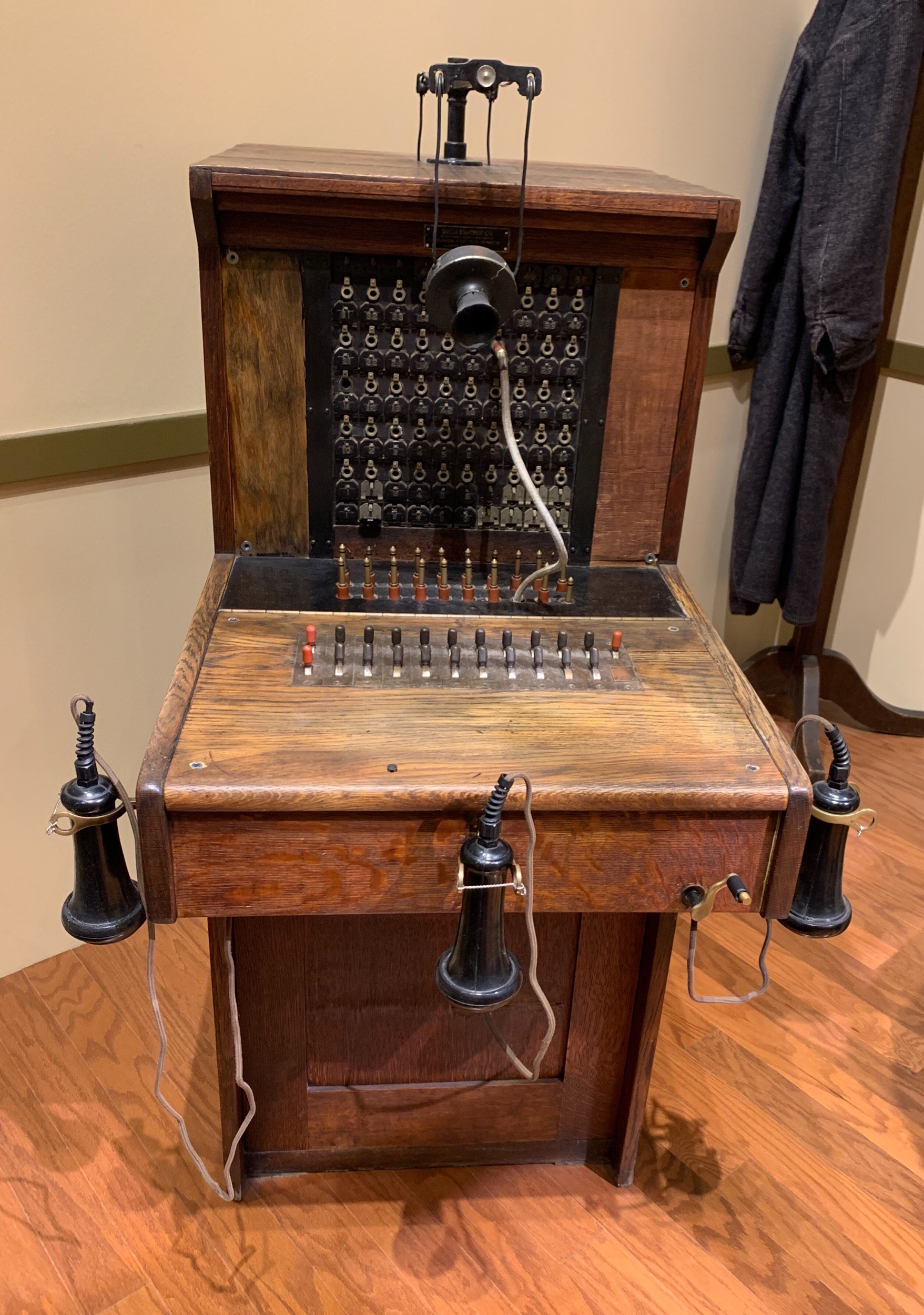 This is from back in the day when a telephone operator had three ears.