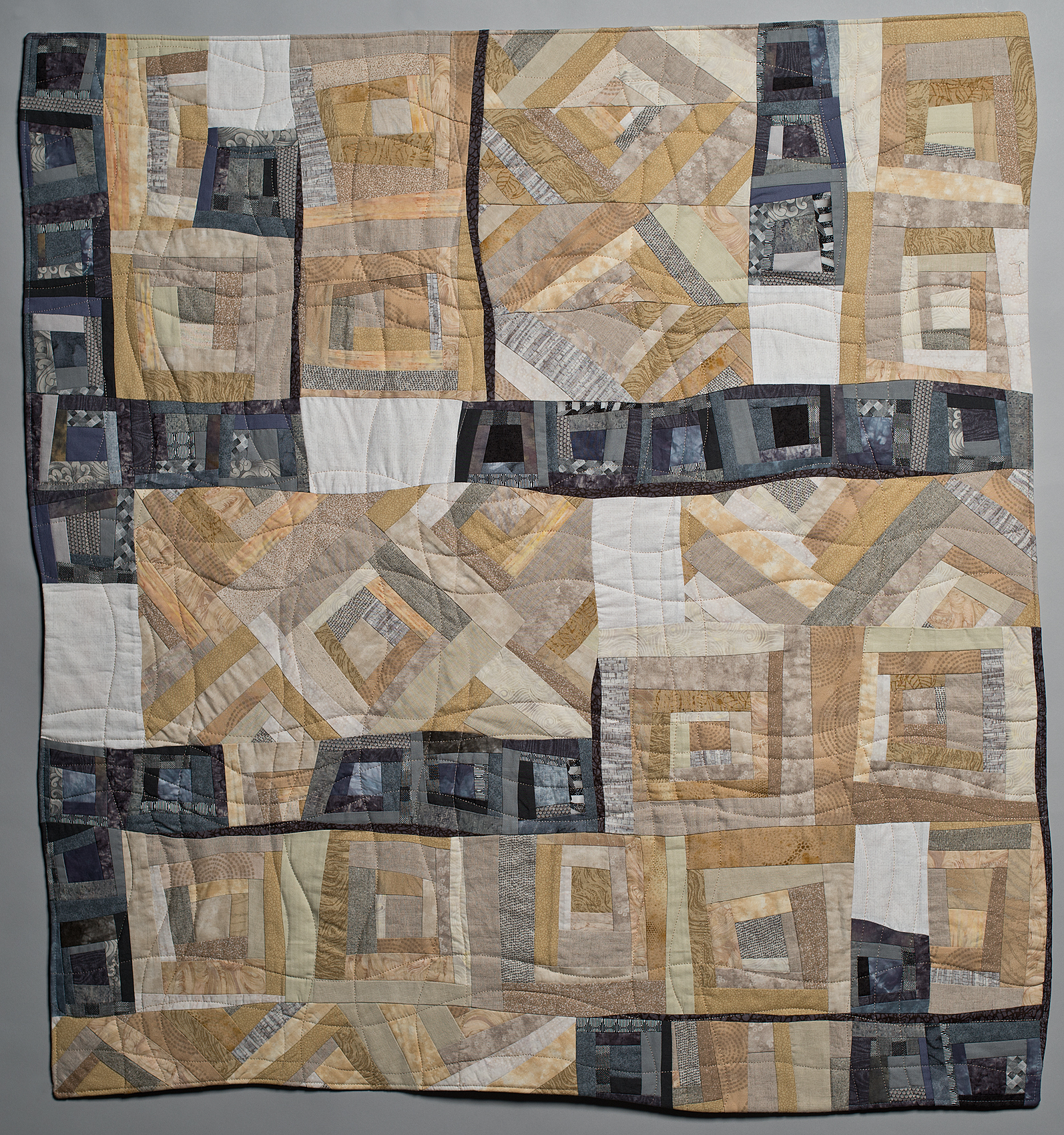 "Collapsing Log Cabins , commercial cotton fabrics, 40"" x 44""."
