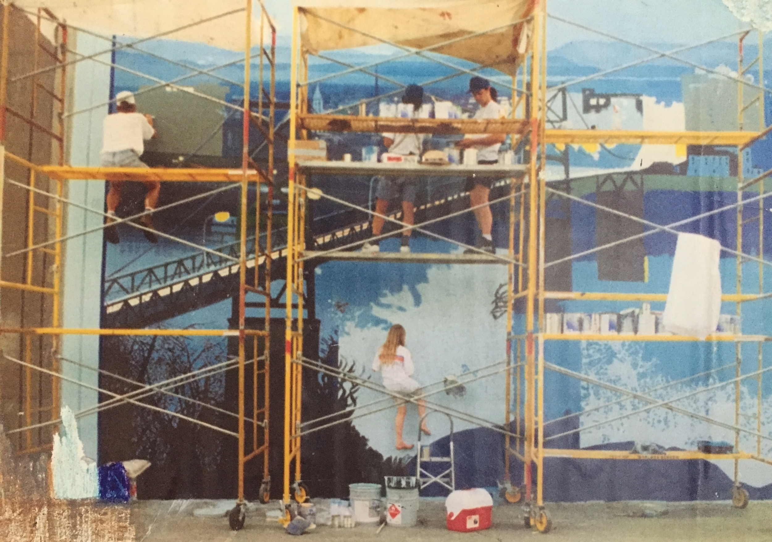 Hellmann at age 9, painting a mural with her father Robert Dafford in Portsmouth, OH.