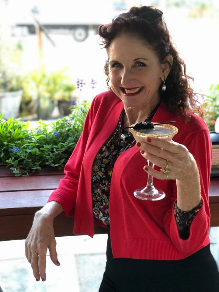 Owner Cynthia Breslin usually can be seen drinking a cold glass of Mohua, a New Zealand Sauvignon Blanc. However, here she is holding a Blackberry Cheesecake Martini!