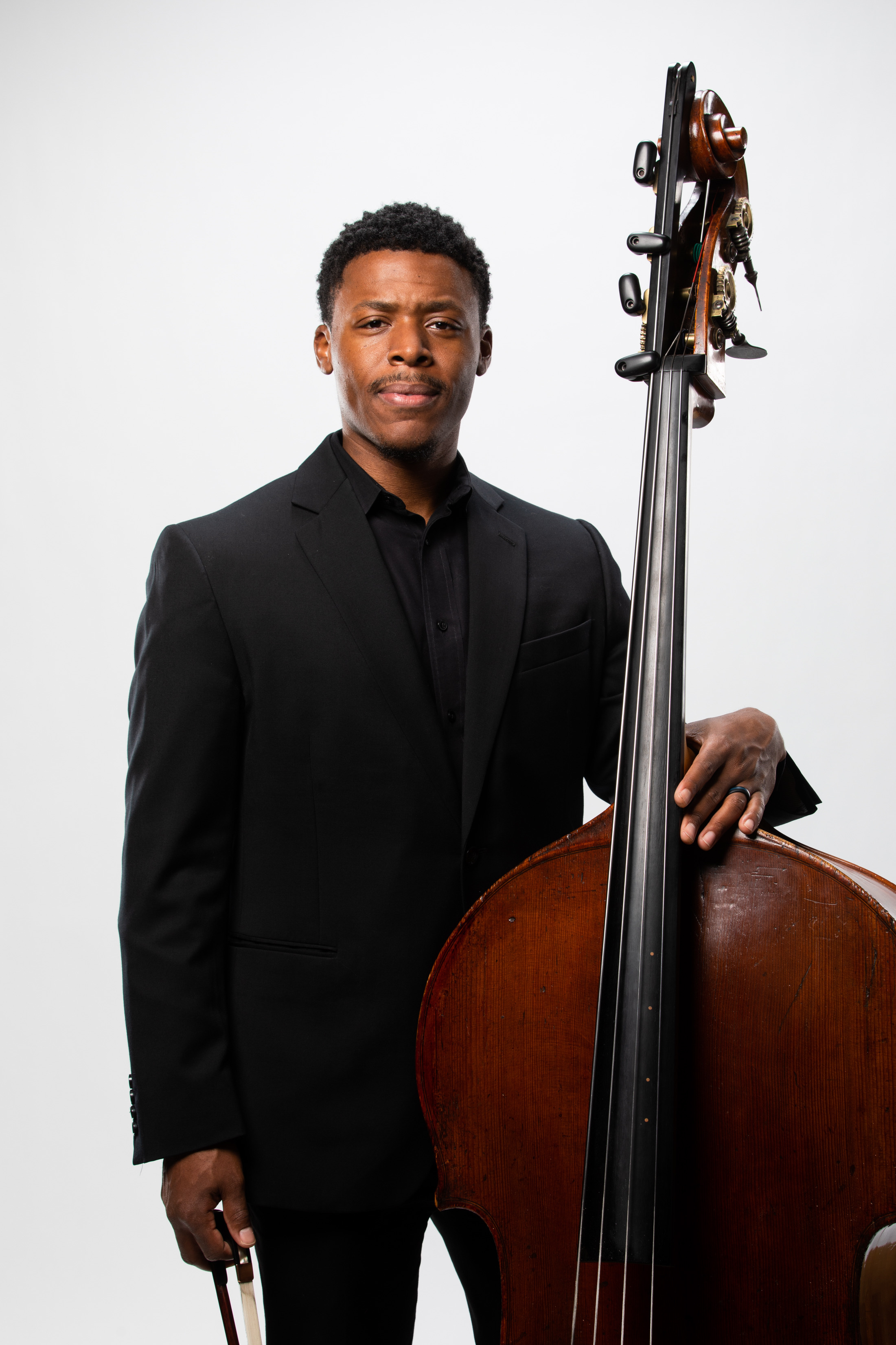Ian Saunders - Double Bass - A multi-faceted musician, Ian Saunders enjoys an exciting career as a sought-after bassist and educator. The Virginia native began his studies with Christopher White, principal bassist of the Virginia Symphony, in his hometown of Norfolk. Within a year he received his first major scholarship from R&B legend Ben E. King. Saunders completed his bachelor's degree under the tutelage of renowned bassist Robert Nairn at the Pennsylvania State University. Saunders continued his graduate studies under Nairn while fulfilling numerous professional engagements.In 2016, he received his doctorate from the University of Maryland while studying with Robert Oppelt, principal bassist of the National Symphony Orchestra. Soon after graduation, Saunders was accepted into the prestigious Diversity Fellowship program with the Cincinnati Symphony Orchestra and Cincinnati College-Conservatory of Music in the Fall of 2017.