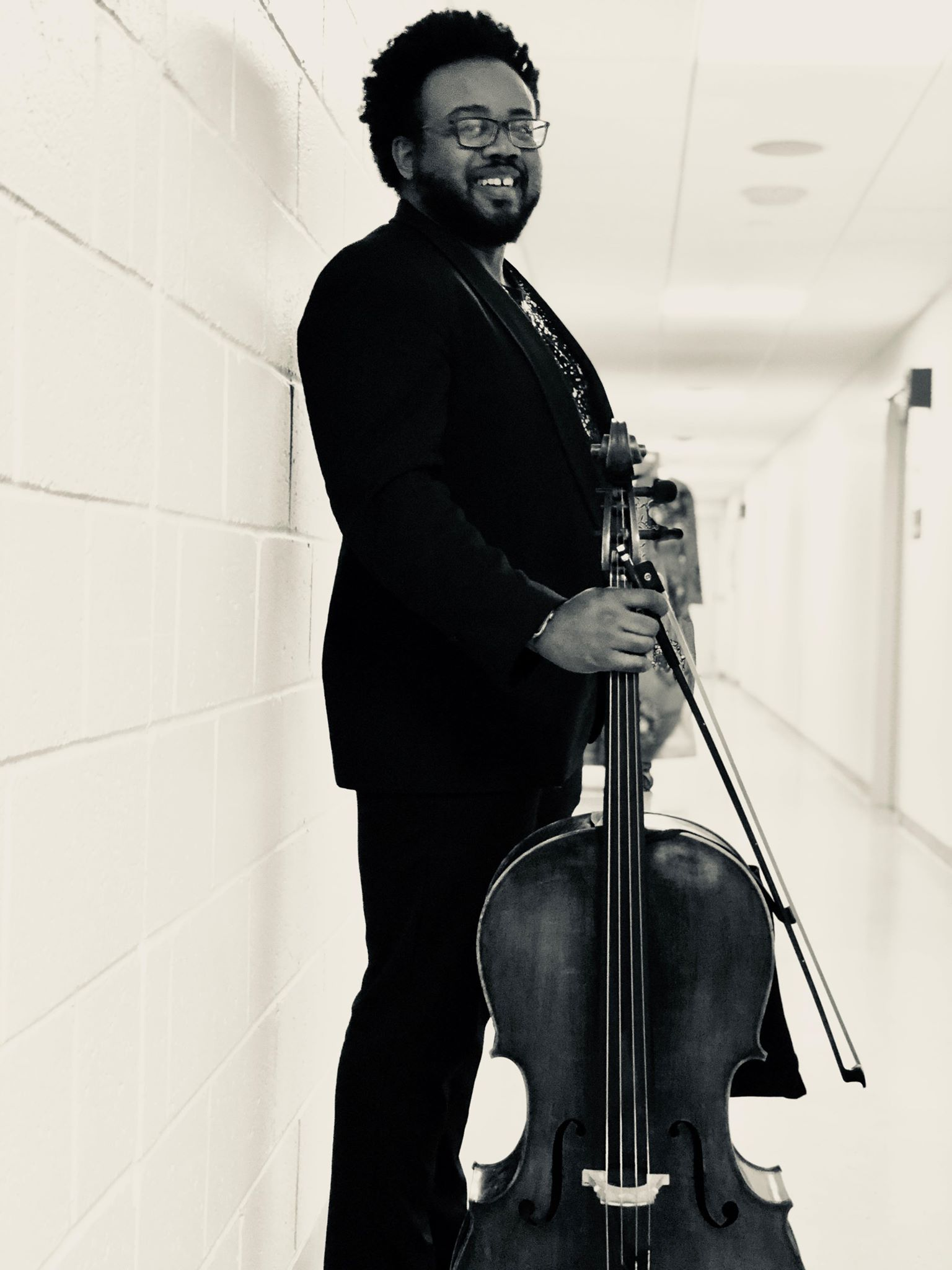 "Kevin Phillip Jones - Cello - Virginia native Kevin Phillip Jones began his cello studies with Alice Glasco and Virginia Symphony cellist Janet Kriner.At Old Dominion University, Kevin began studies with Carter Melin, and continued with Leslie Fritelli. In summers past, he has studied at The North Carolina School for the Arts, The National Symphony Orchestra Summer Music Institute at The Kennedy Center, Aria International Music Festival, and The Meadowmount School of Music (NY).Kevin currently resides in the Washington D.C. metro area, where he was recently soloist with the DC Strings orchestra. He performs with several opera companies including Maryland Lyric Opera, and Washington Opera Society. In addition, he has performed with jazz luminaries like Chelsey Green and The Green Project, and Noble Jolley. For the last two years, he has been a performer in The Pansy Craze variety burlesque show, as well as its house band GYNOCEROS—which recently appeared at the Shenandoah Fringe Festival in Virginia, and he recently completed a Professional fellowship with Hawaii Performing Arts Festival. This year has twice brought him to NPR's Tiny Desk series for ""All Songs Considered"": performing with hip-hop vocalist Mumu Fresh, aka Maimouna Youssef in July, and with Wu-Tang Clan's The RZA in November; in addition to the Distant Worlds Final Fantasy Orchestra, with ‪Nobuo Uematsu‬; the Game of Thrones orchestra tour with series composer Ramin Djawadi, and Father John Misty's 'God's Favorite Customer' tour. Kevin was most recently a guest soloist with the Colour of Music Festival Orchestra in Charleston, South Carolina."