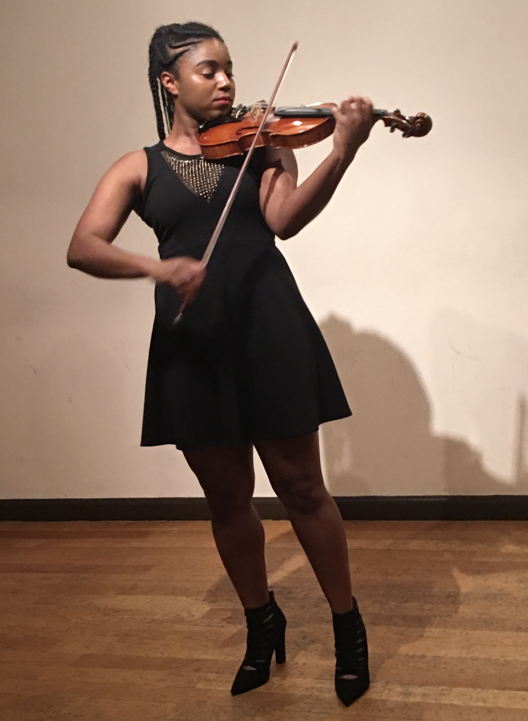 Jordan Pettis - Violin - Born and raised in Denver, Colorado, Jordan Celeste Pettis fell in love with the sound of the violin during her middle school and has . She graduated from the renowned Denver School of the Arts majoring in classical violin and jazz voice. She studied under Ms. Eugenia Alikhanova, first violinist of the Moscow String Quartet. This rigorous training prepared her for a musical journey where she has performed with the Boston Pops, members of the Chicago Symphony; and many other collaborations from classical to funk to hip-hop, and more. After graduating from Illinois Wesleyan University with a Bachelor of Music Performance Degree in 2012, she moved to Boston in 2013 to study Jazz Voice and Jazz Violin at the New England Conservatory of Music- receiving a Certificate of Jazz Performance in January of 2015.In 2015, Jordan became a member of the Ill-Harmonic Orchestra and has performed with them at the Tobin Center, the Kennedy Center, and Carnegie Hall among other fantastic venues.