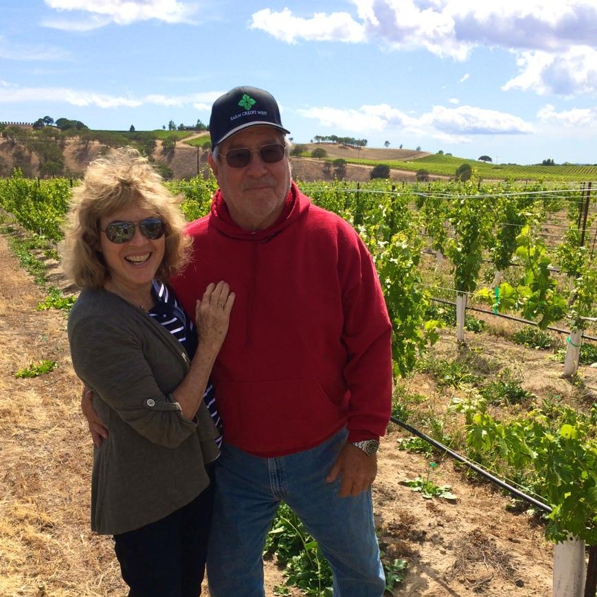 Serena & Michael in the vineyard.