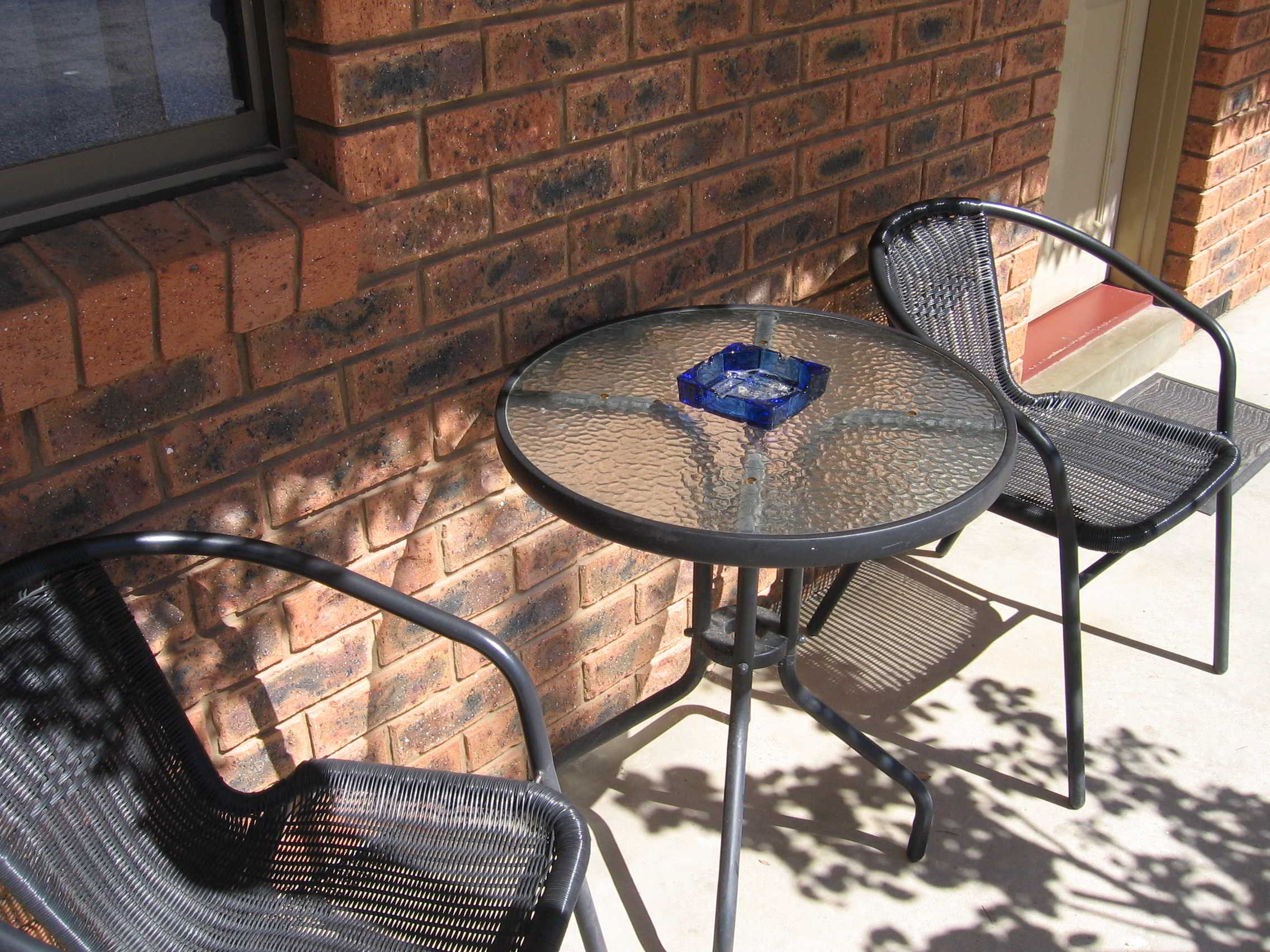 Chairs at front of motel room