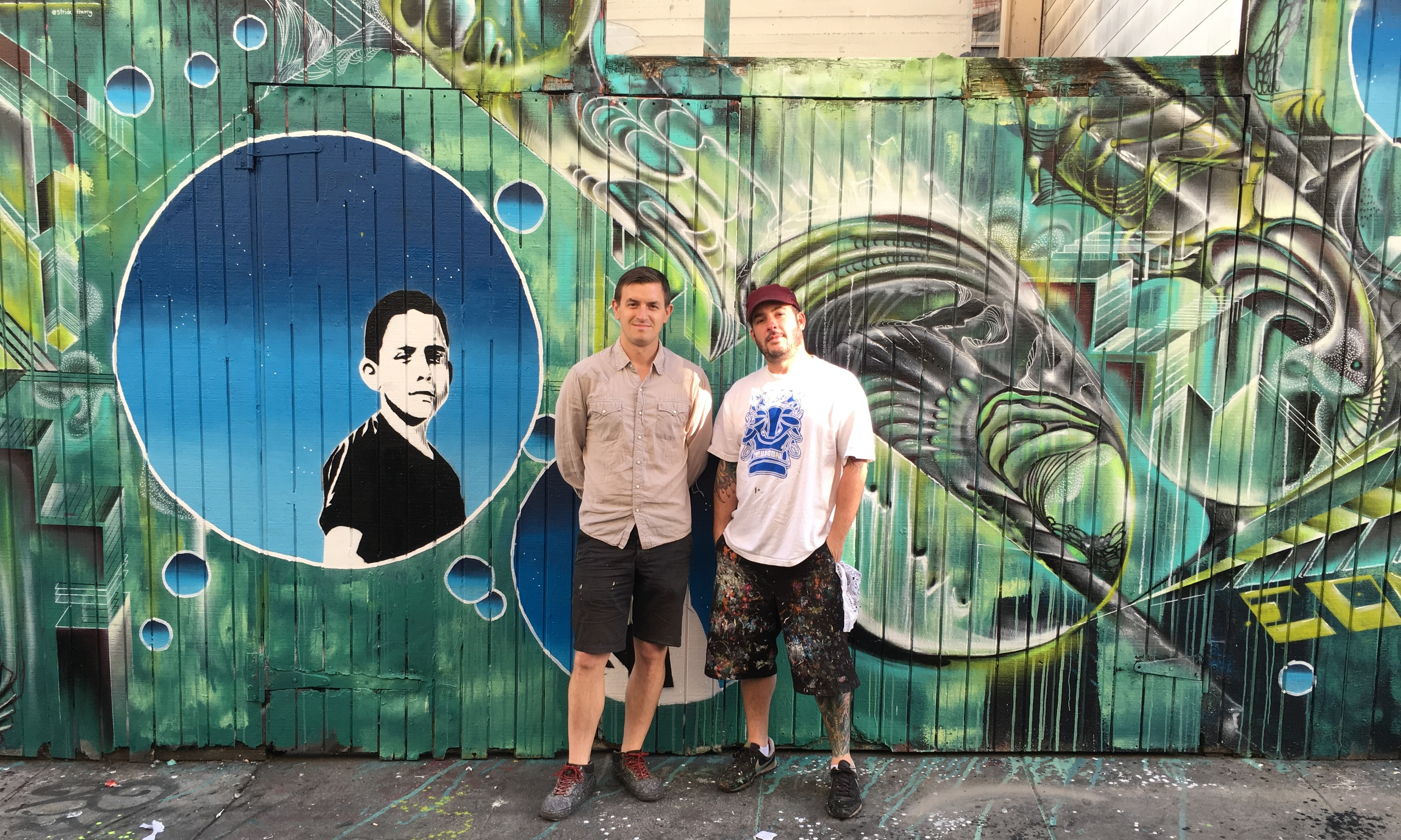 Strider Patton and Max Ehrman in front of their mural in Clarion Alley, San Francisco, CA.